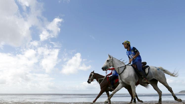 Competitors compete on the beach during the Endurance Competition at the World Equestrian Games at Dragey