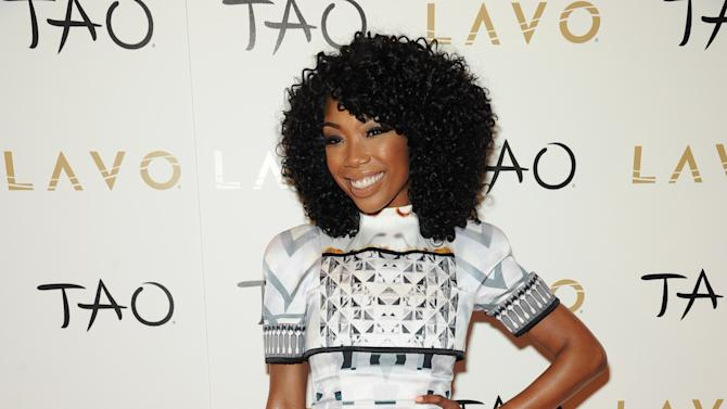 IMAGE DISTRIBUTED FOR TAO - In this image released on Wednesday Jan. 2, 2013, R&B singer, Brandy walks the red carpet showing off her engagement ring at Lavo Nightclub on New Years Eve in Las Vegas. (Photo by Al Powers/Powers Imagery for TAO/Invision/AP)