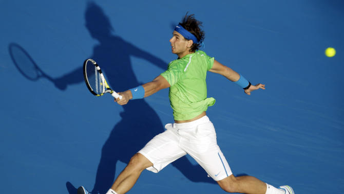 "FILE - This Dec. 31, 2011 file photo shows Spain's Rafael Nadal returning the ball to Roger Federer of Switzerland during the final day of Abu Dhabi Mubadala Tennis Championship in Abu Dhabi, United Arab Emirates. Nadal has confirmed he is ready to return to competitive tennis at the end of the month in an exhibition tournament in Abu Dhabi, following a six-month break to recover from a knee injury. The 11-time Grand Slam champion said on his Facebook page Tuesday, Dec. 11, 2012, that he ""can't wait to get back on court in Abu Dhabi,"" and that he ""would love to get my hands on the trophy again this year!"" (AP Photo/Kamran Jebreili, File)"