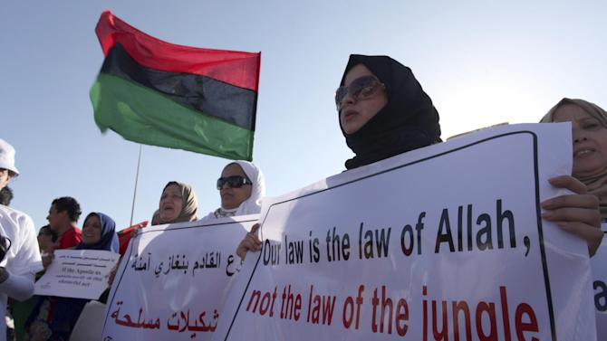 Libyan women protest against Ansar al-Shariah Brigades and other Islamic militias in front of the Tebesty Hotel, in Benghazi, Libya, Friday, Sept. 21, 2012. The attack that killed the U.S. ambassador and three other Americans has sparked a backlash among frustrated Libyans against the heavily armed gunmen, including Islamic extremists, who run rampant in their cities. More than 10,000 people poured into a main boulevard of Benghazi, demanding that militias disband as the public tries to do what Libya's weak central government has been unable to.(AP Photo/Mohammad Hannon)