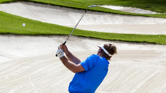 Russell Henley chips out of a greenside bunker on the fourth hole during the third round of the Sony Open golf tournament, Saturday, Jan. 12, 2013, in Honolulu.  (AP Photo/Marco Garcia)