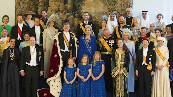 Dutch King Willem-Alexander and his wife Queen Maxima pose for a group photo with their Royal guests inside the Royal Palace in Amsterdam, The Netherlands, Tuesday April 30, 2013. Around a million people are expected to descend on the Dutch capital for a huge street party to celebrate the first new Dutch monarch in 33 years. (AP Photo/Michel Porro, pool)