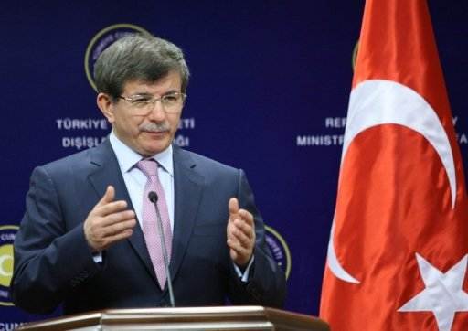 Turkish Foreign Minister Ahmet Davutoglu, pictured during a press conference in Ankara, on July 19, 2013. Turkey will join an international coalition against neighbouring Syria even if the UN Security Council fails to reach consensus on the issue, Davutoglu said in an interview published on Monday