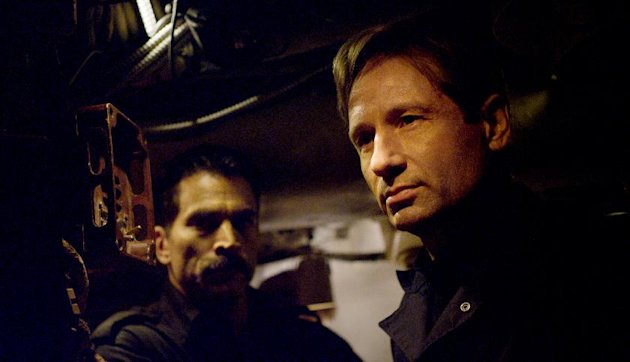 This film image released by RCR Media Group shows David Duchovny, right, and Johnathon Schaech in a scene from &quot;Phantom.&quot; (AP Photo/RCR Media Group)