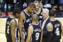 Spurs coach Popovich speaks to his players near the end of the fourth quarter against the Heat in Game 6 of their NBA Finals basketball playoff in Miami