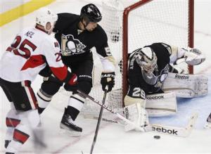 Pittsburgh Penguins goalie Fleury blocks a shot by Otttawa Senators' Neil as Penguins' Engelland tries to defend in their NHL hockey game in Pittsburgh