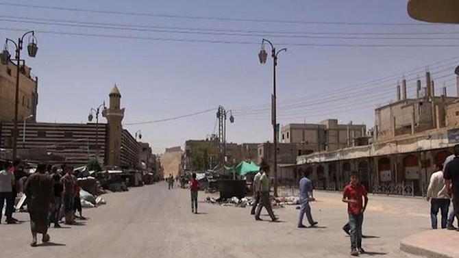 An image grab taken from a video made available by Jihadist media outlet Welayat Homs on May 21, 2015 allegedly shows people walking in a street of Syria's ancient city of Palmyra after the Islamic State (IS) group's jihadists seized it