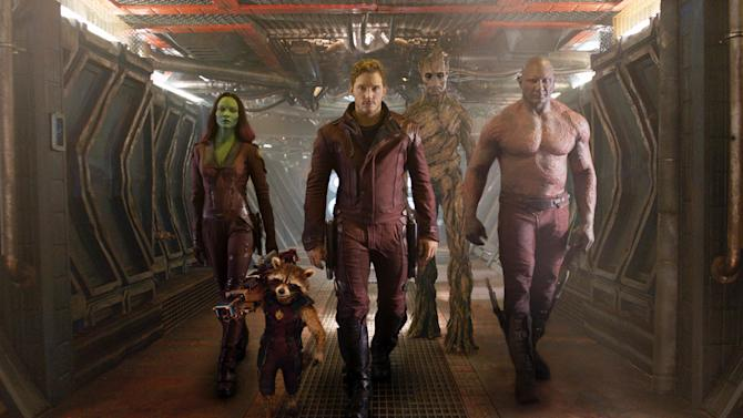 "FILE - This undated image released by Disney - Marvel shows, from left, Zoe Saldana, the character Rocket Racoon, voiced by Bradley Cooper, Chris Pratt, the character Groot, voiced by Vin Diesel and Dave Bautista in a scene from ""Guardians Of The Galaxy"".(AP Photo/Disney - Marvel, File)"