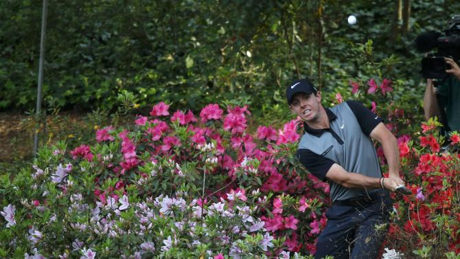 Northern Ireland's Rory McIlroy hits from the azaleas on the 13th hole during the second round of the Masters golf tournament at the Augusta National Golf Club in Augusta