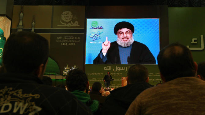 "Hezbollah leader Sheik Hassan Nasrallah speaks via a video link, during a ceremony to mark Islam's Prophet Muhammad's birth in the southern suburbs of Beirut, Lebanon, Friday, Jan. 25, 2013. Nasrallah, a staunch ally of the Syrian regime, said those who had dreamed about ""dramatic changes"" taking place in Syria should let go of their dreams. He said all military, political and international indications showed that President Bashar Assad's regime cannot be defeated. (AP Photo/Bilal Hussein)"