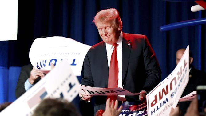 Republican presidential candidate Donald Trump signs autographs during the National Federation of Republican Assemblies at Rocketown in Nashville