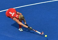 Britain&#39;s Crista Cullen shoots a goal during their women&#39;s field hockey bronze medal match against New Zealand at The Riverbank Arena in London. Britain won 3-1