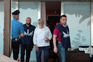 &lt;p&gt;Italian anti-mafia police flank Giuseppe Mandara (centre) after his arrest near Naples. Mandara is the head of the biggest buffalo mozzarella manufacturing company in Italy.&lt;/p&gt;