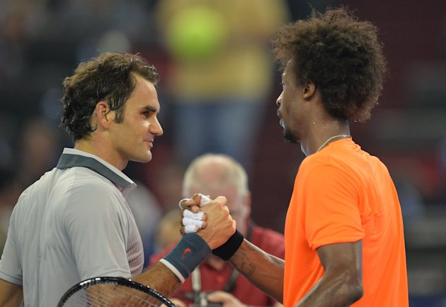 Gael Monfils was sporting a different 'do when he and Federer played last fall in Shanghai, China. (AFP Photo/Peter Parks)
