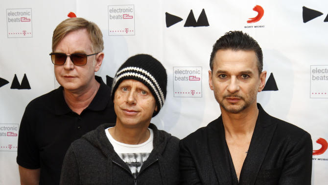 FILE - This March 24, 2013 file photo shows, from left, Andrew Fletcher, Martin Gore and Dave Gahan, from Depeche Mode at the  Depeche Mode Delta Machine Album launch in Vienna, Austria. Depeche Mode, The Cure, Muse will perform at Austin City Limits Festival on Oct. 4-6 and 11-13. (AP Photo/Ronald Zak, file)