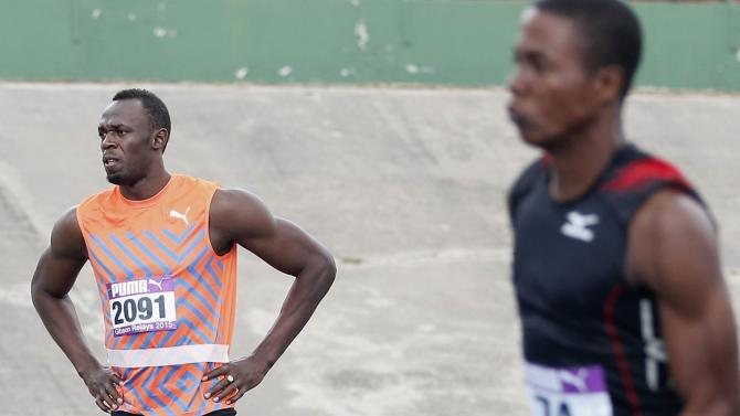 Jamaica's Usain Bolt is pictured before running the final leg of his first race of the season during the Gibson Relays in Kingston