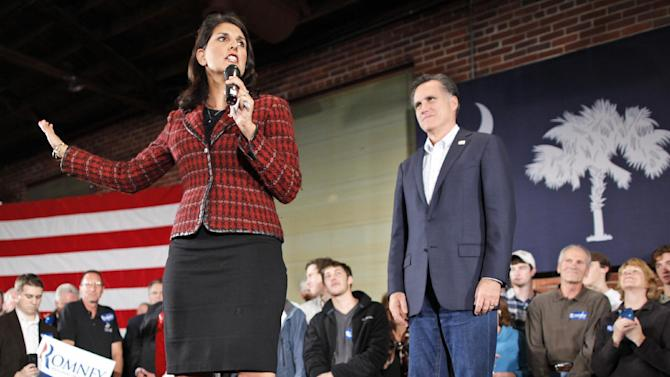 FILE - In tbhis Jan. 11, 2012 file photo, Republican presidential candidate, former Massachusetts Gov. Mitt Romney, campaigns with South Carolina Gov. Nikki Haley in Columbia, S.C. When Republican presidential candidate Mitt Romney picks his running mate, odds are he'll select someone with far less wealth than his own. Unless he chooses Hewlett-Packard CEO Meg Whitman, one of the richest women in America. Some of the potential Republican vice presidential nominees are grappling with the same financial issues as many of their countrymen. (AP Photo/Charles Dharapak, File)
