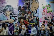 Visitors queue in front of billboards showing anime characters during the 14th Ani-Com and Games exhibition in Hong Kong. One of Asia's biggest animation and comic fairs opened Friday in Hong Kong, attracting thousands of fans and bringing some fun back into super heroes after the Batman movie shootings in Colorado