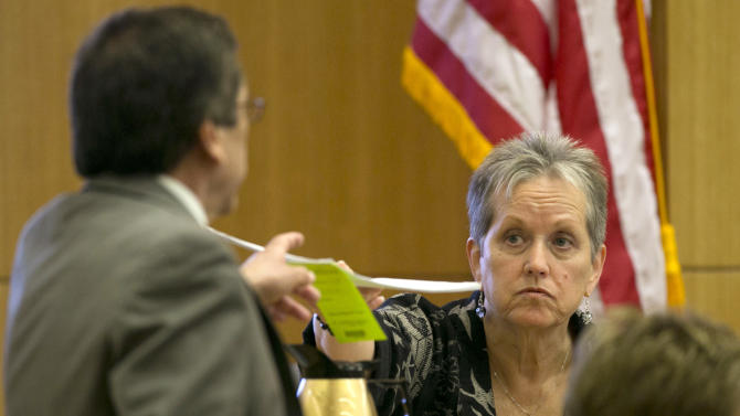 "Alyce LaViolette a domestic violence expert returns evidence to Prosecutor Juan Martinez during cross examination during the Jodi Arias trial at Maricopa County Superior Court in Phoenix on Wednesday, April 10, 2013.  ""Isn't it true that Mr. Alexander was extremely afraid of the defendant Jodi Arias based on her stalking behavior?"" prosecutor Juan Martinez asked LaViolette on Wednesday.  Arias is on trial for the killing of her boyfriend, Travis Alexander, in 2008.   (AP Photo/The Arizona Republic, David Wallace, Pool)"