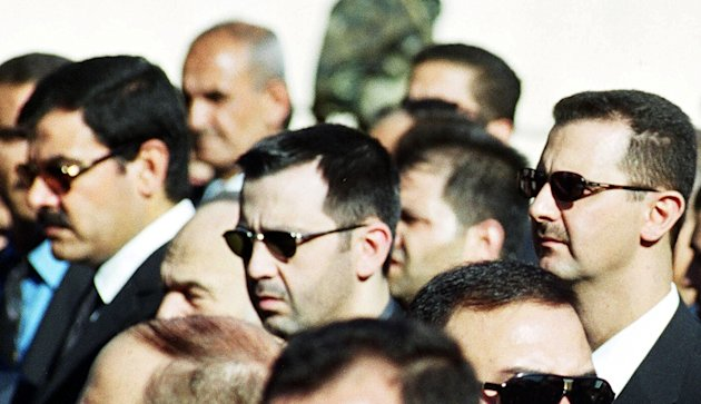 FILE - In this June 13, 2000 file photo, Syrian President Bashar Assad, right, his brother Maher, center, and brother-in-law Major General Assef Shawkat, left, stand during the funeral of late president Hafez Assad in Damascus, Syria. Maher Assad, the president's youngest brother, commands Syria's best equipped army division and six brigades of the Republican Guards, responsible for security in the capital, Damascus. He is known for his hot temper and ruthless tactics.(AP Photo, File)