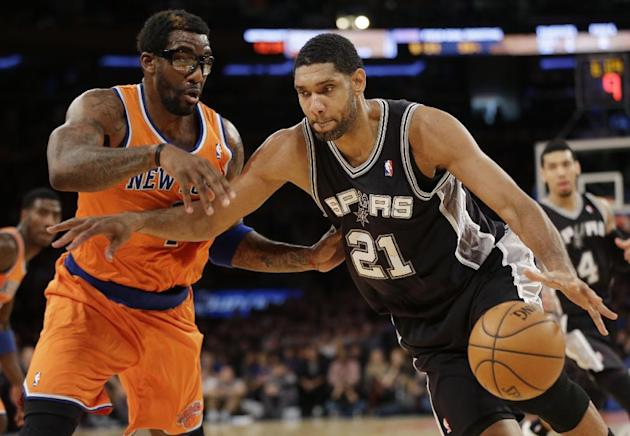 San Antonio Spurs' Tim Duncan, right, moves past New York Knicks' Amare Stoudemire during the first half of an NBA basketball game at Madison Square Garden, Sunday, Nov. 10, 2013, in New York