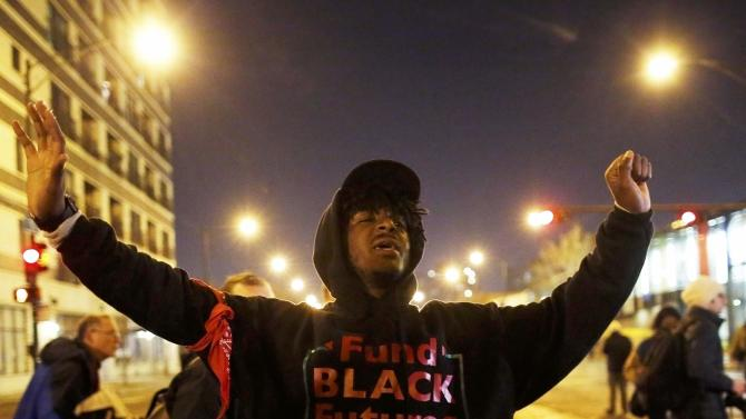 A demonstrator chants as he marches through the streets during protests in Chicago