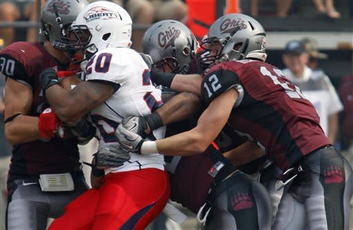 Montana makes big plays, beats Liberty 34-14