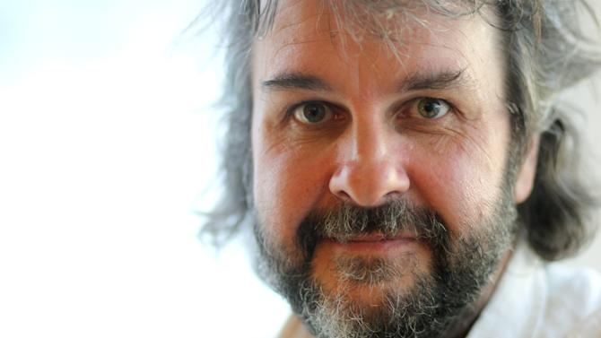 """FILE - In this Saturday, July 14, 2012 file photo, director Peter Jackson, from the film """"The Hobbit: An Unexpected Journey,"""" poses for a portrait during Comic-Con, in San Diego. The filmmaker behind """"The Lord of the Rings"""" trilogy, said superheroes may rule in Hollywood, but he has no interest in doing a comic-book adaptation himself. (Photo by Matt Sayles/Invision/AP, File)"""