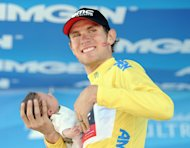 SANTA ROSA, CA - MAY 19:  Tejay van Garderen of the United States riding for BMC Racing celebrates his win of the Tour California while holding his baby after Stage 8 on May 19, 2013 in Santa Rosa, California.  (Photo by Harry How/Getty Images)