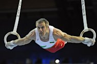 Bulgaria's Jordan Jovtchev competes on the rings during the 28th European Men's Artistic Gymnastics Championships on May 11, 2008 at Malley sports center in Lausanne. Netherlands' Yuri Van Gelder won ahead of Bulgaria's Jordan Jovtchev and France's Danny Pinheiro Rodrigues.   AFP PHOTO/FABRICE COFFRINI