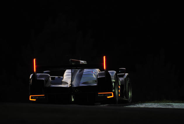 Audi Sport driver Romain Dumas, of France, goes through a corner during night practice for the American Le Mans Series' Petit Le Mans auto race at Road Atlanta, Thursday, Sept. 29, 2011, in Braselton,