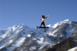 Snowboarder Roope Tonteri of Finland performs a jump during slopestyle snowboard training at the 2014 Sochi Winter Olympics in Rosa Khutor