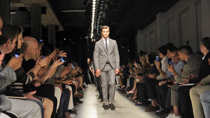 Models on parade at the end of the Bottega Veneta men's Spring-Summer 2014 collection, part of the Milan Fashion Week, unveiled in Milan, Italy, Sunday, June 23, 2013. (AP Photo/Giuseppe Aresu)