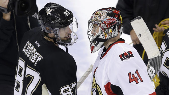 Pittsburgh Penguins' Sidney Crosby (87) shakes hands with Ottawa Senators goalie Craig Anderson (41) after Game 5 of the Eastern Conference semifinals in their NHL hockey Stanley Cup playoffs series on Friday, May 24, 2013 in Pittsburgh. The Penguins won the game 6-2 and won the series 4-1 to advance to the Eastern Conference finals. (AP Photo/Gene J. Puskar)