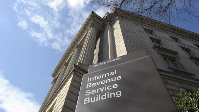 FILE - This March 22, 2013 file photo shows the exterior of the Internal Revenue Service building in Washington. A Treasury investigator says collections from delinquent taxpayers dropped for the second straight year in 2012, due in part to budget cuts at the Internal Revenue Service. In 2011, enforcement revenue dropped by more than $2 billion. Last year, it dropped by $5 billion more, to a little more than $50 billion. At the same time, a new Treasury report says the IRS is opening more delinquent taxpayer accounts than it is closing. (AP Photo/Susan Walsh, File)