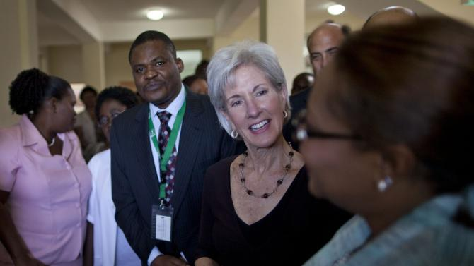 U.S. Secretary of Health and Human Services Kathleen Sebelius, center, talks to a health worker during a visit to Eliazar Germain hospital in Port-au-prince, Haiti, Monday, April 16, 2012. Sebelius is visiting Port-au-Prince to highlight the United States' ongoing partnership with the Haitian government to strengthen healthcare in the country, especially with respect to the prevention of infectious diseases. (AP Photo/Ramon Espinosa)