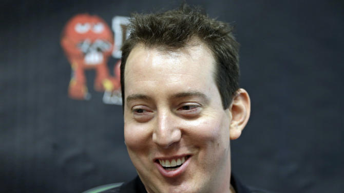 Kyle Busch answers a question from the media during a news conference at Joe Gibbs Racing in Huntersville, N.C., Thursday, Jan. 24, 2013, as part of the NASCAR Sprint Cup Media Tour. (AP Photo/Chuck Burton)