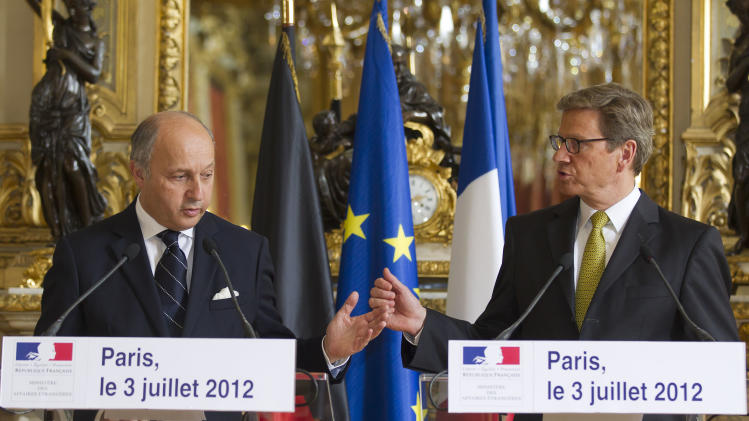 "French Foreign Minister Laurent Fabius, left, and German Foreign Minister Guido Westerwelle gesture while speaking to the media during a joint press conference in Paris. France will host a meeting in Paris of the ""Friends of Syria"" on July 6 of countries that back the departure of Syrian President Bashar Assad. (AP Photo/Michel Euler)"