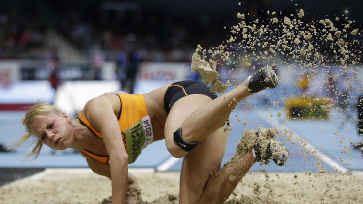 Netherlands' Nadine Broersen makes an attempt in the long jump of the women's pentathlon during the Athletics Indoor World Championships in Sopot, Poland, Friday, March 7, 2014. (AP Photo/Matt Dunham)