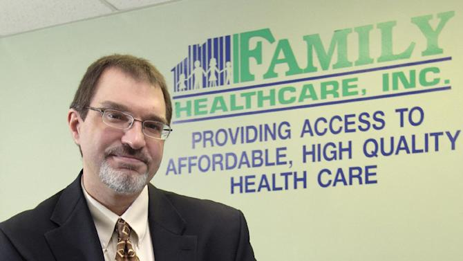 In this Thursday, March 28, 2013 photo, Mark Bridenbaugh, CEO of Family Healthcare Inc., poses for a photo in their offices, in Chillicothe, Ohio. A shortage of primary care physicians in parts of the country is expected to worsen as millions of newly insured Americans gain coverage under the federal health care law next year. (AP Photo/Jay LaPrete)