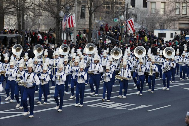 The Punahou Band and JROTC, Punahou School, Honolulu, Hawaii, performs in President Barack Obama's inaugural parade in Washington, Monday, Jan. 21, 2013, following the president's ceremonial swearing-