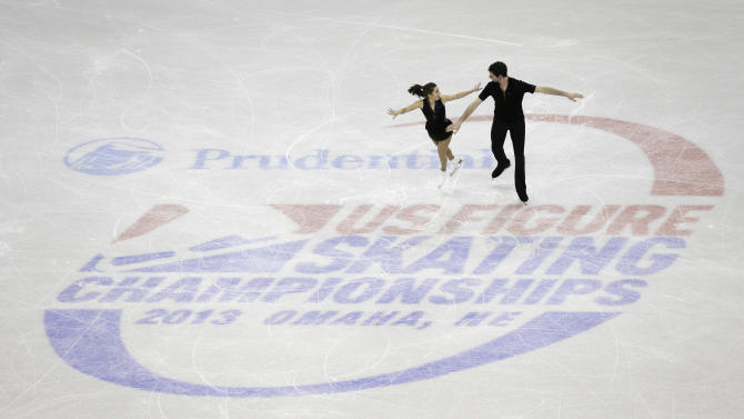Marissa Castelli, left, and Simon Shnapir compete in the senior pairs short program at the U.S. figure skating championships on Thursday, Jan. 24, 2013, in Omaha, Neb. (AP Photo/Charlie Neibergall)