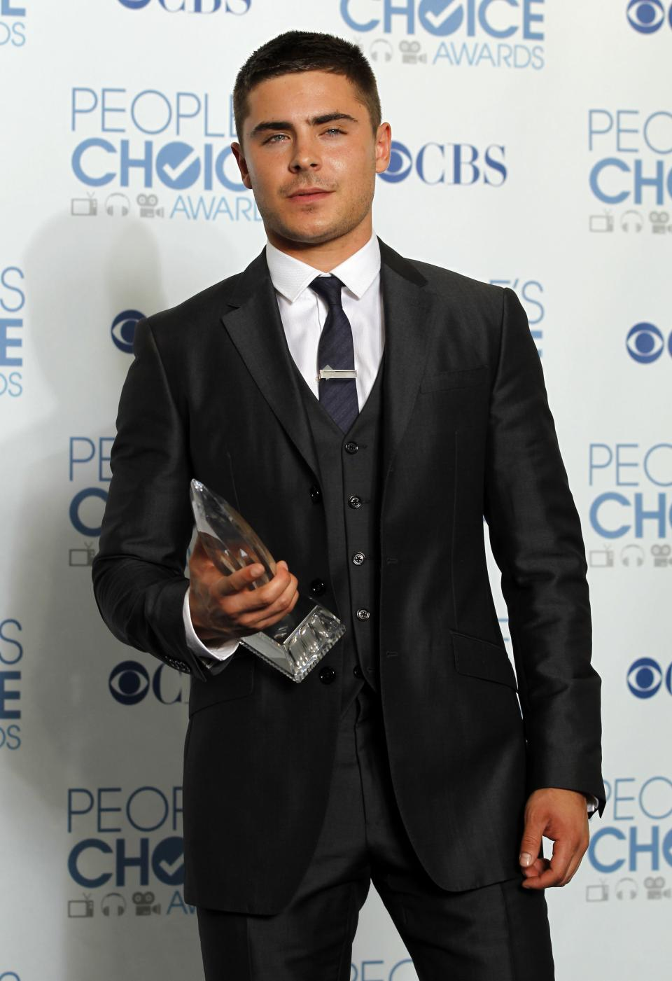 Zac Efron poses for a photo backstage with the award for favorite movie star under 25 presented by Moviefone at the People's Choice Awards on Wednesday, Jan. 5, 2011, in Los Angeles. (AP Photo/Matt Sayles)