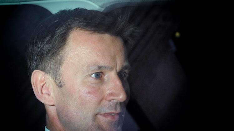 British Culture Secretary Jeremy Hunt leaves his office in central London for the House of Commons in Westminster , London Wednesday April 25 2012. Hunt is to make a statement to Parliament about his part in the News Corporation bid to take over BSkyB, after the release of a cache of emails yesterday sparked demands for his resignation. Speculation that Rupert Murdoch was seeking to inflict political pain on the Cameron's Conservatives mounted Tuesday when his son James gave damning testimony about British Olympics czar Jeremy Hunt, releasing documents which suggested that the Conservative minister had secretly smoothed the way for News Corp.'s proposed takeover of British Sky Broadcasting Group PLC. (AP Photo/Stefan Rousseau/PA Wire)  UNITED KINGDOM OUT