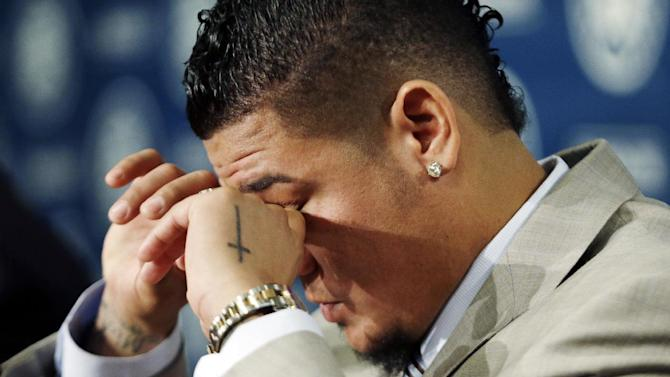 "Seattle Mariners' Felix Hernandez dries his eyes during a news conference, Wednesday, Feb. 13, 2013, in Seattle. Hernandez, who repeatedly said, ""I will not disappoint anybody,"" signed a seven-year contract with the Mariners that makes him the highest-paid pitcher in baseball. The new deal will be worth $175 million. (AP Photo/Elaine Thompson)"