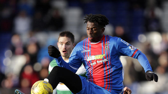 Inverness Caledonian Thistle's Andrea Mbuyi Mutombo (R) in action with Celtic's Mikael Lustig
