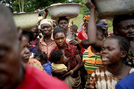 Internally displaced people wait for food distribution by a foreign NGO in Boda