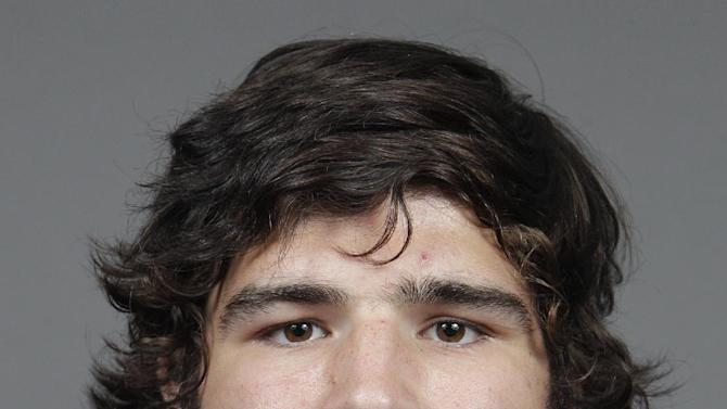 This photo taken on Wednesday, Sept. 11, 2013 and provided by Ohio State university shows college football player Kosta Karageorge in Columbus, Ohio.  The mother of a missing Ohio State football player has told police he texted her about his prior concussions the morning he disappeared. A missing-person report filed with Columbus police Wednesday evening, Nov. 26, 2014, says Karageorge told his mother he was sorry if he was an embarrassment but concussions had his head messed up. The 6-foot-5 senior missed practice Wednesday and Thursday and has not been heard from. (AP Photo/Ohio State University, Jay LaPrete)