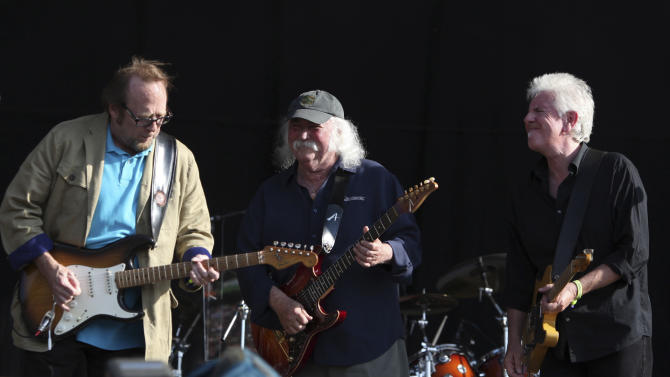 FILE - In this June 27, 2010 file photo, Stephen Stills, from left, David Crosby and Graham Nash, from the band Crosby, Stills and Nash perform in Hyde Park, London. The band surprised the audience when they walked onstage uncharacteristically dressed in formal dark gray Brooks Brothers suits for a benefit concert with Wynton Marsalis' Jazz at Lincoln Center Orchestra, Saturday, May 4, 2013, in New York. (AP Photo/Andy Paradise, file) EDITORIAL USE ONLY.