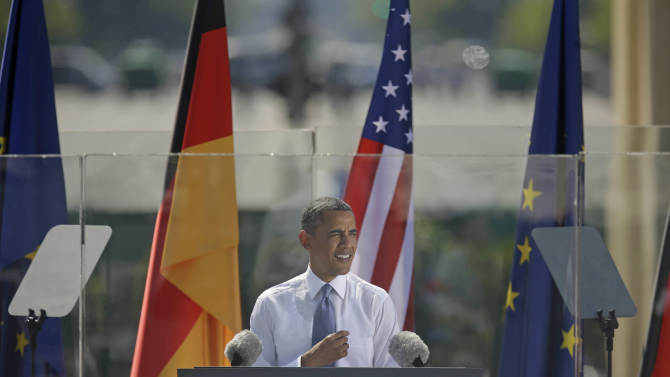 """President Barack Obama speaks in front of the iconic Brandenburg Gate in Berlin Germany, Wednesday, June 19, 2013. Obama is planning a major push using executive powers to tackle the pollution blamed for global warming in an effort to make good on promises he made at the start of his second term. """"We know we have to do more — and we will do more,"""" Obama said in Berlin. (AP Photo/Pablo Martinez Monsivais)"""